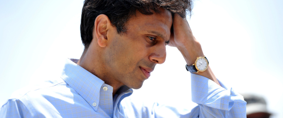 Louisiana Governor Bobby Jindal listens