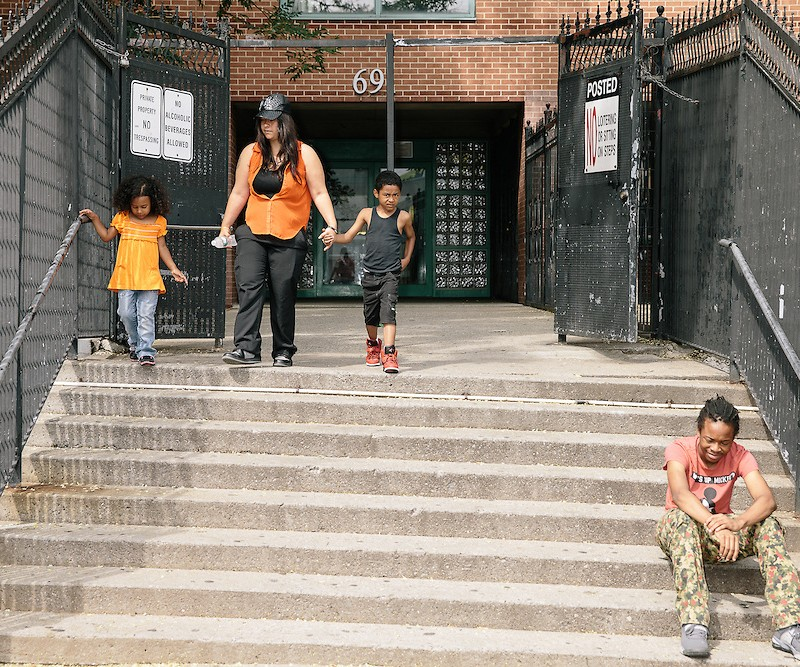 NEW YORK, NY - AUGUST 2, 2014:  Danielle Stalluto walks her two children out of the South Bronx shelter they all live in.  Portraits of three of New York City's homeless population fighting to stay off the street.    CREDIT: Brett Carlsen
