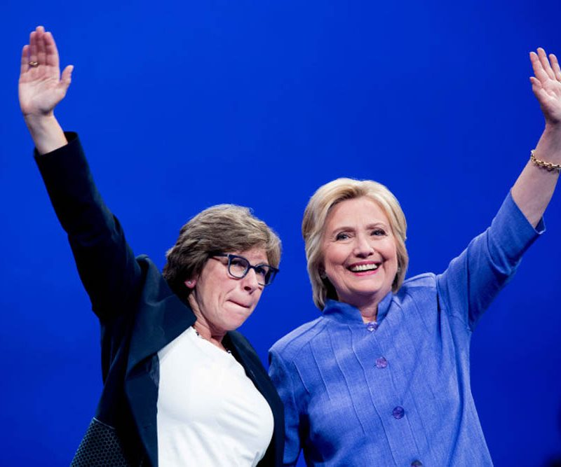 Democratic presidential candidate Hillary Clinton waves with AFT President Randi Weingarten, left, after speaking at the American Federation of Teachers convention at the Minneapolis Convention Center in Minneapolis, Monday, July 18, 2016. (AP Photo/Andrew Harnik)